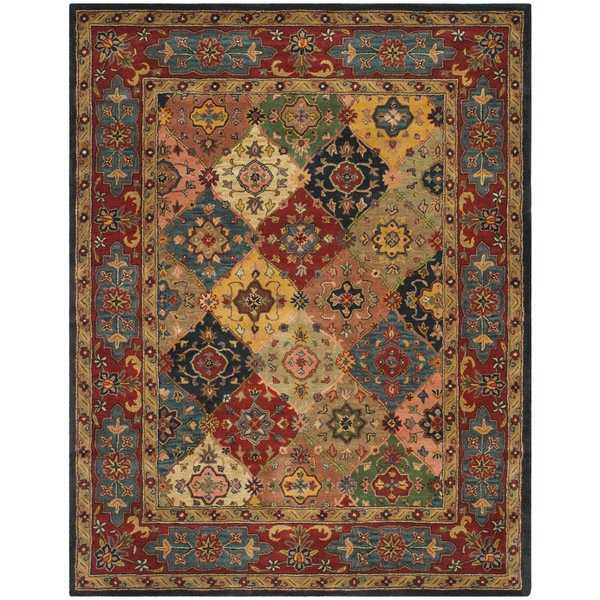Safavieh Handmade Heritage Timeless Traditional Red Wool Rug - 9'6' x 13'6'